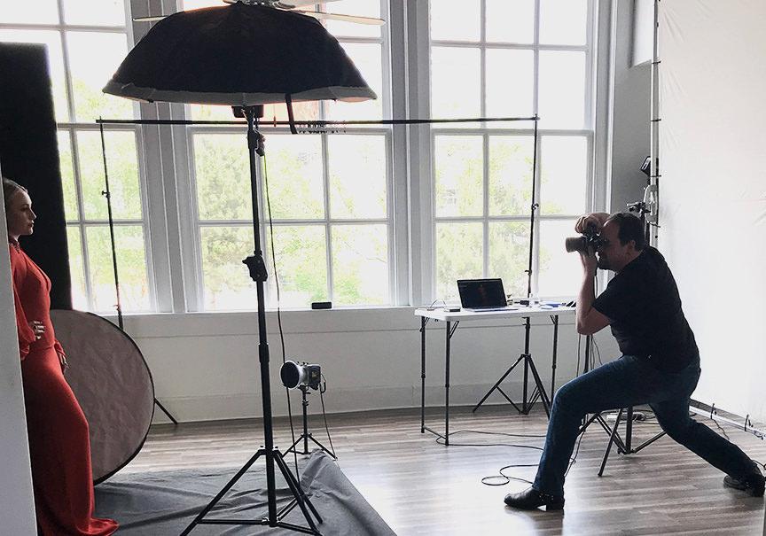 Headshot and portrait photographer Ben Marcum photographing a model in the studio using Paul C. Buff, Inc. lights.