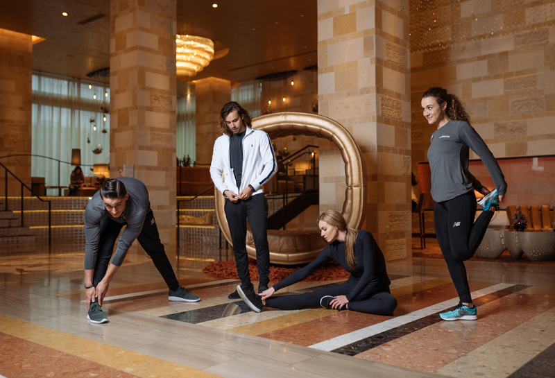 runWestin participants stretching in the lobby photographed by Tausha Dickinson.