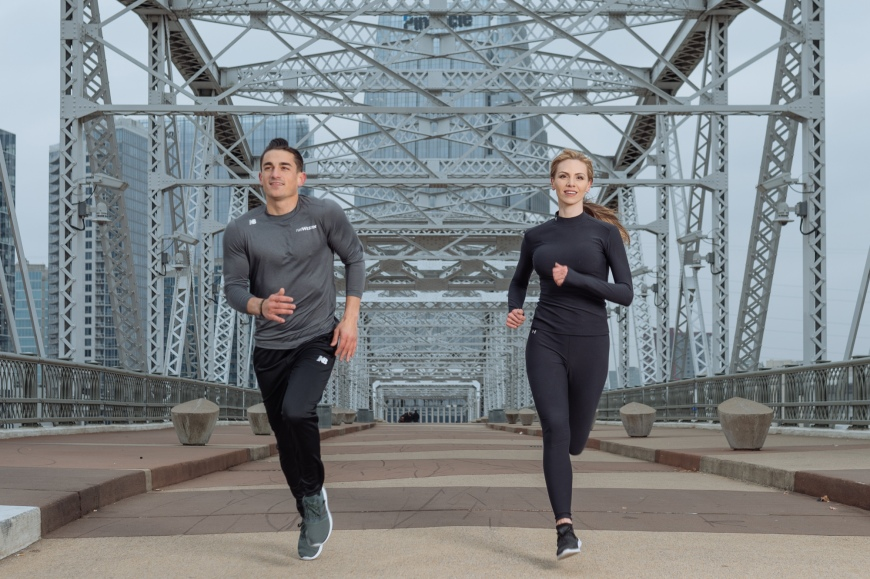Two runners photographed by Tausha Dickinson running on the pedestrian bridge in Nashville, TN for the runWESTIN program.