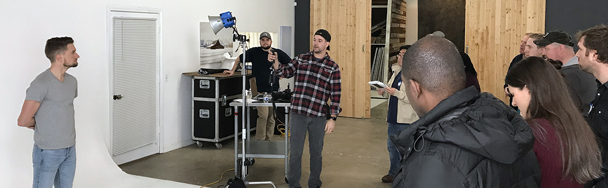 Jeff Carpenter of Readylight Media speaks to the Next Level Lighting workshop attendees with model Hunter Hethcoat at Westlight Studios in Franklin, TN.