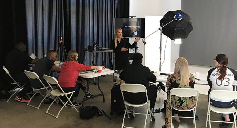 Allee-Sutton Hethcoat shares posing tips with the Next Level Lighting Workshop attendees