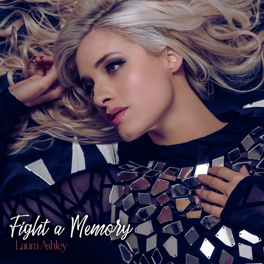 'Fight a memory' by Laura Ashley single art. Woman in mirrored dress laying on the floor.